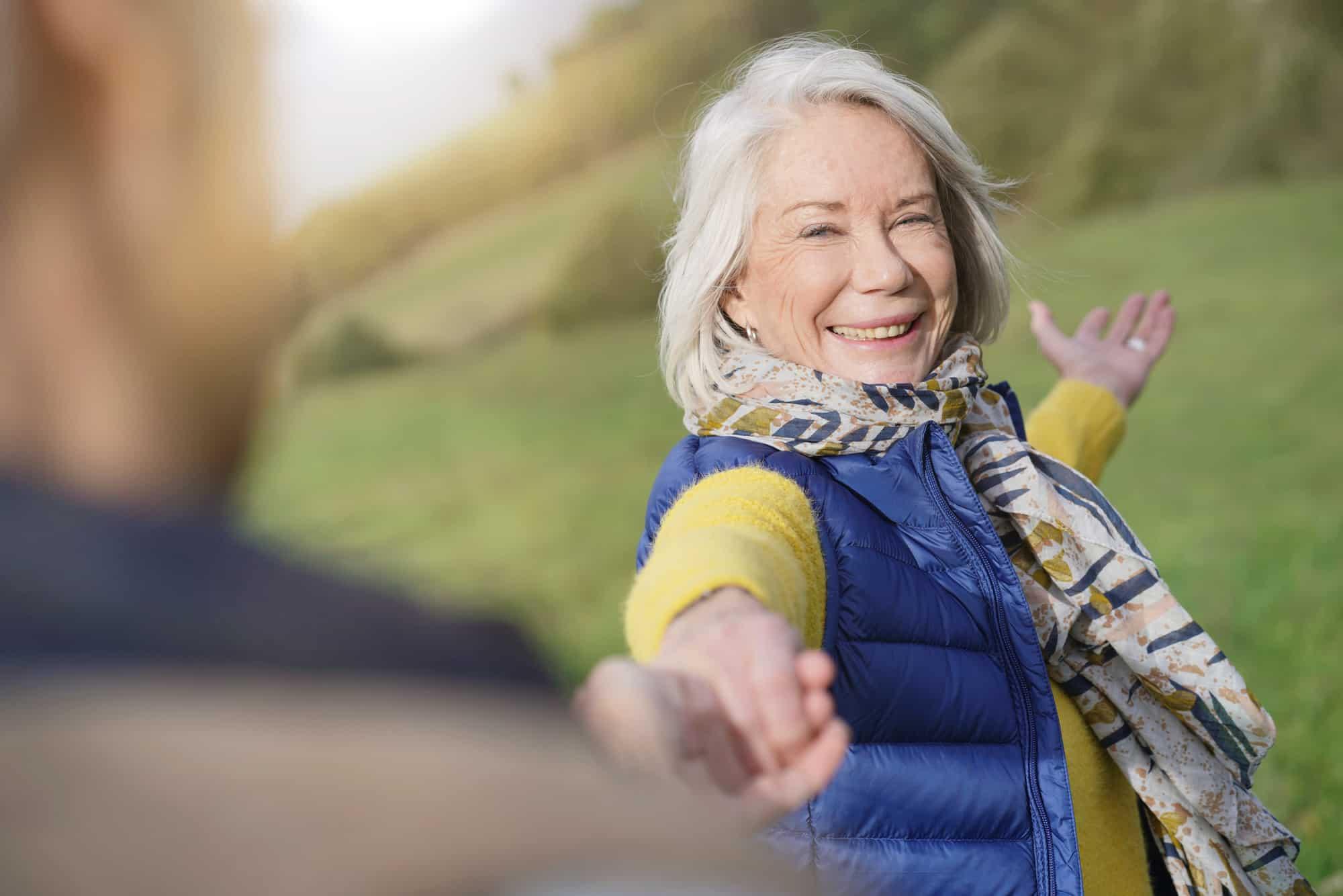 Book coach - older woman lending a hand